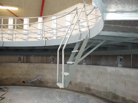 Steel platform with centre pit and stair access